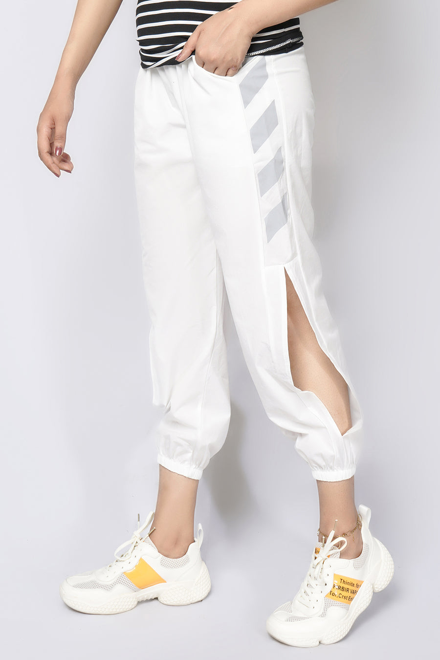 Track pants with cut out and stripes white