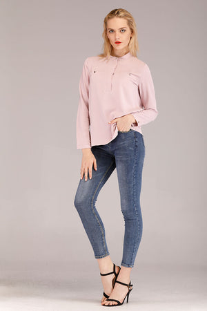 SOLID COLORED TOP WITH BUTTONED POCKETS