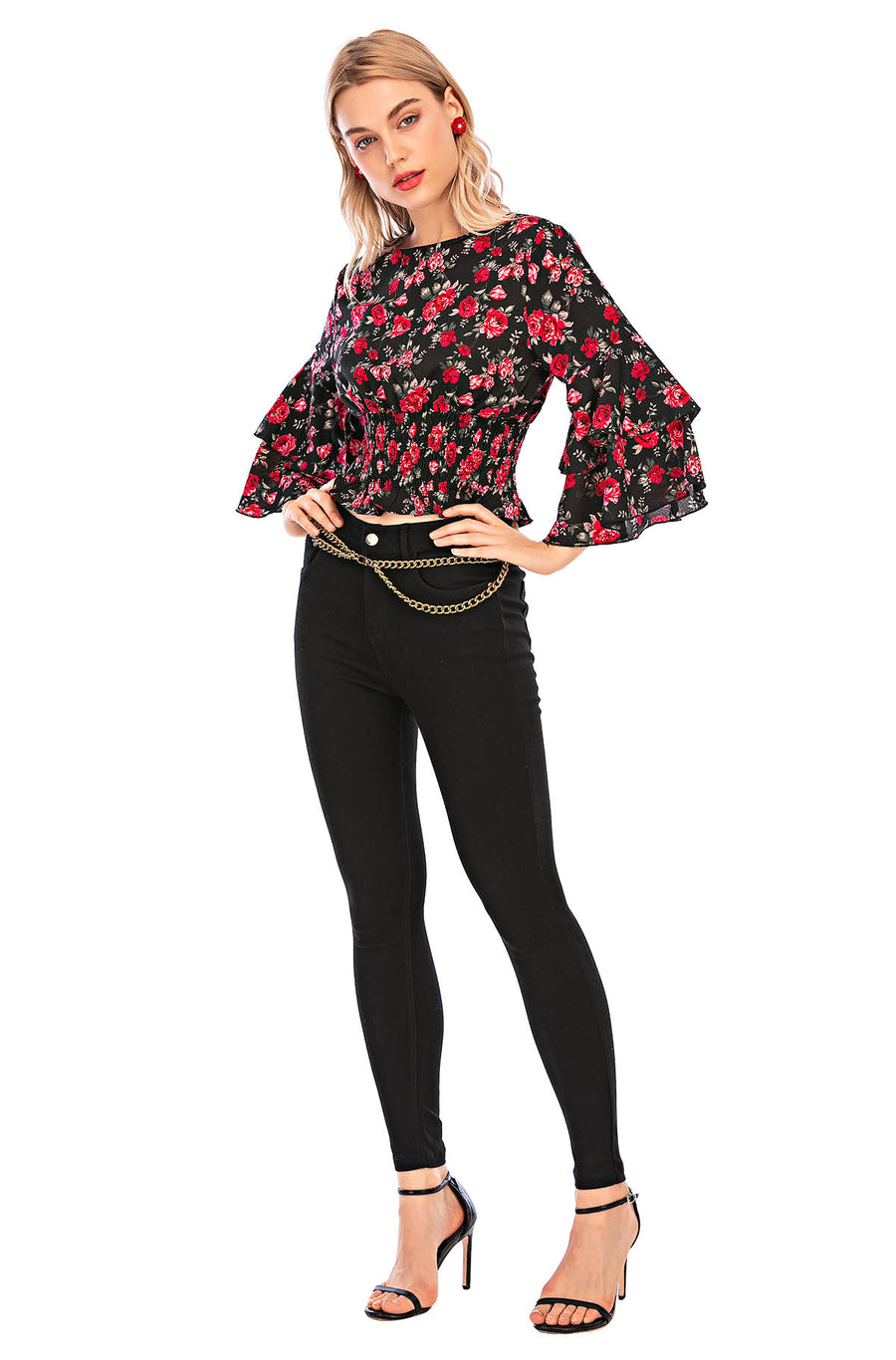 Floral top with smocked waist and  flare sleeves