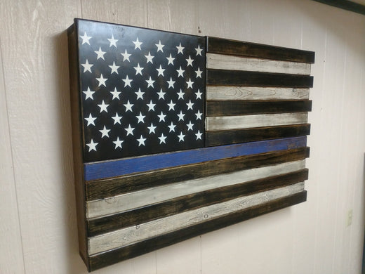 b899f1138b65 A side view of a large wooden American gun concealment flag in black and  white with