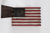 Upper left open panel of a gun concealment flag with pistol and magazine, remaining design includes deep red and white stripes over dark wood