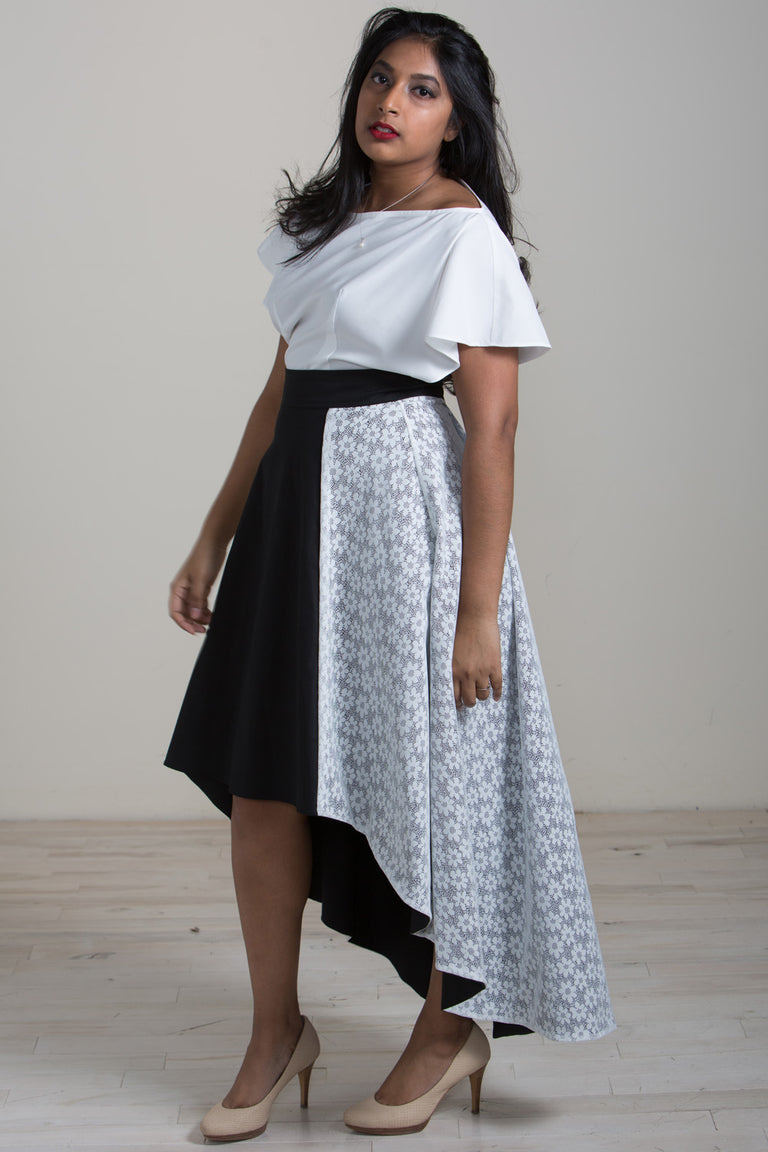 Hensa two-piece dress with flutter sleeve and colour block lace skirt.