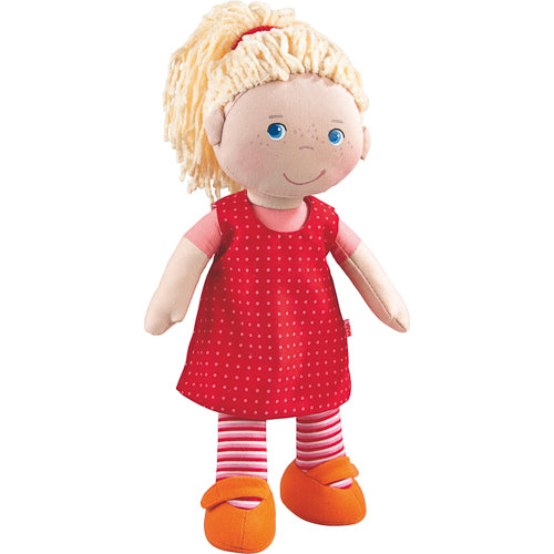 "Keepsake stuffed doll by Haba is a cuddly first friend. The perfect non-toxic, educational infant toy and new baby gift. Suggested for 18 months and up Fits other HABA 12-13.75"" outfits and accessories (sold separately) HABA soft dolls are machine washable on cold (do not spin dry) She stands 12"" tall Comes in a closed window box"