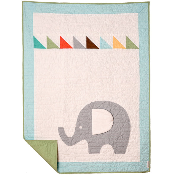 "Grown, sewn & handcrafted in the USA this 100% cotton baby/toddler quilt is sure to be an heirloom to pass down. Measuring 36""x48"" the Mint backing with modern wavy line quilting accentuate the elephant that is machine appliquéd by skilled sewers. Fun bold color triangle pieces at the top add visual interest to the big gray giant. The floppy ear is padded with cotton batting."