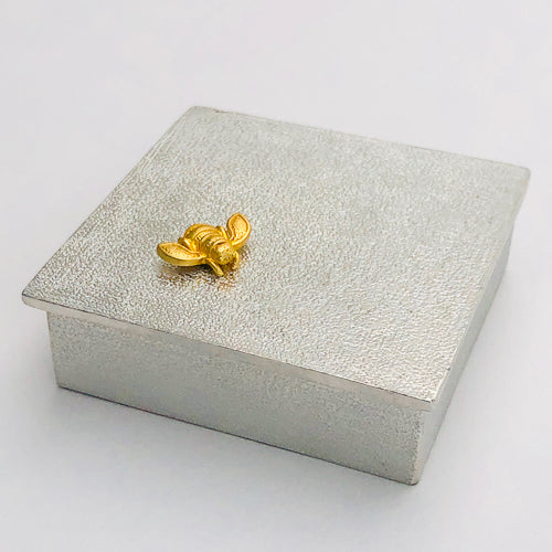 "Stunning 100% lead-free fine pewter treasure box from Danforth Pewter.  Featuring a golden honeybee, this keepsake item would be a lovely bridal party or graduation gift.  Cast in 100% lead-free fine pewter Measures 2 1/4"" x 2 1/4"" x 3/4"" Made in Vermont Beautifully gift boxed"