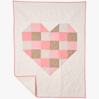 "Grown, sewn & handcrafted in the USA this 100% cotton baby/toddler quilt is sure to be an heirloom to pass down. The neutral and pink shades together are so gentle and sweet.  Light cream backing. Show your XOXO with this unique swirly heart quilting. The quilt is 36""x48"" and is prewashed for a snuggly cozy feel."