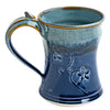 Handmade in USA by local artisan, ceramic 8oz mug in blue featuring an intricate floral pattern detail. Microwave/dishwasher safe.