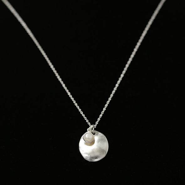 "This handcrafted sterling silver necklace with simply pearl detail is ultra-beautiful in its Simplicity.  Pearl - promotes purity and simplicity 925 Sterling Silver Artisan-made Beautifully boxed for gift giving Adjustable chain length: 16"" extends to 18"""
