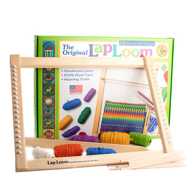 "Perfect for beginners looking to learn how to loom! Artisan crafted hardwood Lap Loom kit includes: Cotton Warp String, 6 Tubes of Colorful 100% Pure Virgin Wool Weft Yarn, Tapestry Needle, 2 Wooden Shed Sticks, 2 - 8"" Wooden Stick Shuttles, & Illustrated Instructions.. Made in the USA."