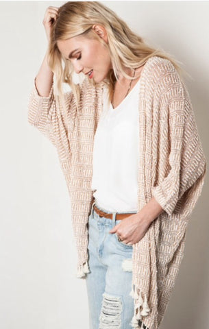 Knit shrug with tassels