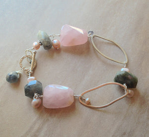 Rose Quartz and labradorite sterling silver bracelet with oval rings.