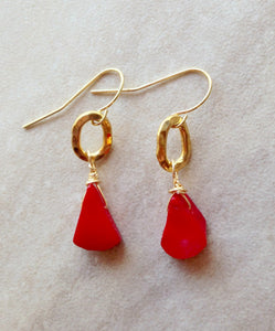 Coral red drop earrings.