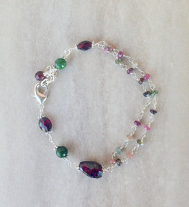 Tourmaline beaded bracelet with garnet nugget.