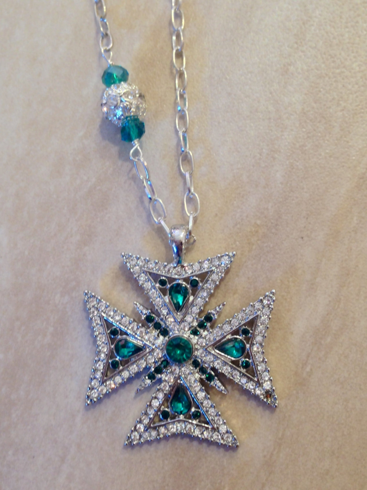 Crystal and Emerald studded Maltese cross necklace.