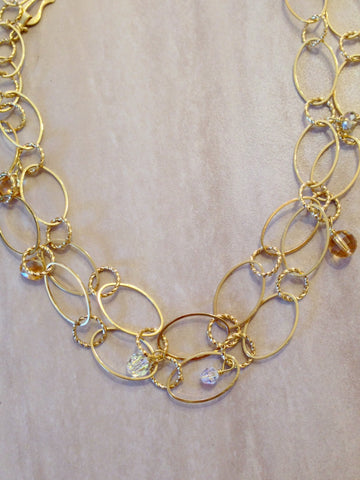 Fancy gold 16mm oval and circle chain necklace.