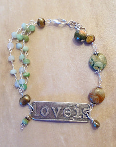 Charm bracelet with green opal, rhyolite and pearls.