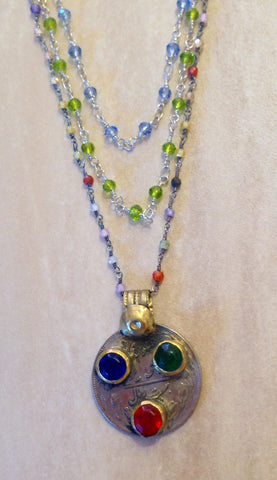 Tibetan gemstone pendant necklace with multiple strands.