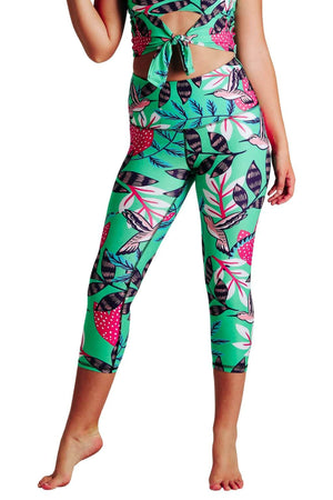 Yoga Democracy Women's Eco-friendly yoga capris crop leggings in Early Bird green with hummingbirds print. USA made from post-consumer recycled plastic bottles. Sweat wicking, anti-microbial, and quick dry ultra-soft brushed fabric.
