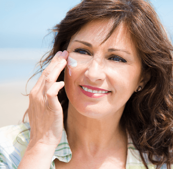 woman applying product to her face