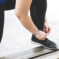 woman runner wearing small medical bracelet