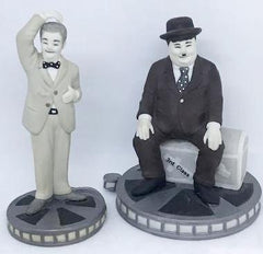 "Laurel & Hardy Black and White Porceline Figures on Film cans by Larry Harmon Pictures circ 2000 (4 1/2"")"