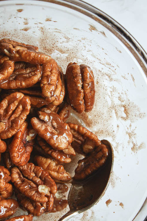 coating pecans with cinnamon honey mixture | Tennessee Valley Pecan Company