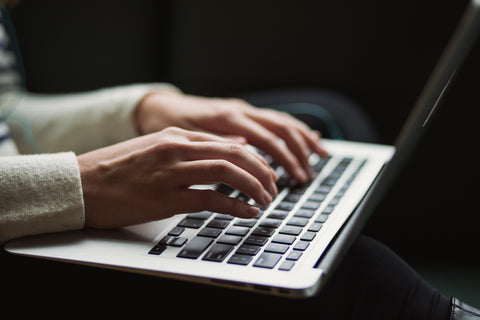 Person Typing | Photo by Kaitlyn Baker on Unsplash