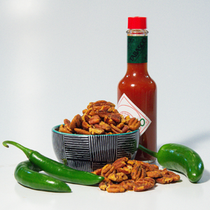 spicy pecans posed with Tabasco sauce and jalapeno peppers | gourmet pecans | Tennessee Valley Pecan Company