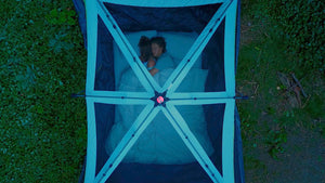 Couple sleeping on twilight thermal mattress topper in tent