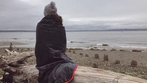 Woman on beach with Alki Blanket