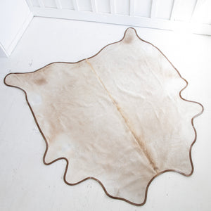 Champagne Cowhide with Leather Trim