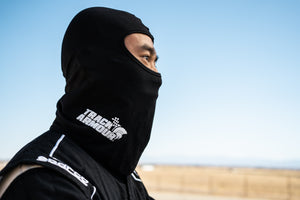 Profile View of Man wearing Black Head Sock