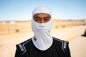 Man wearing White Track Armour Head Sock