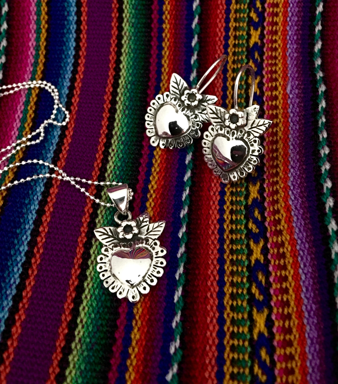 Heart blossoms milagro style set in sterling silver