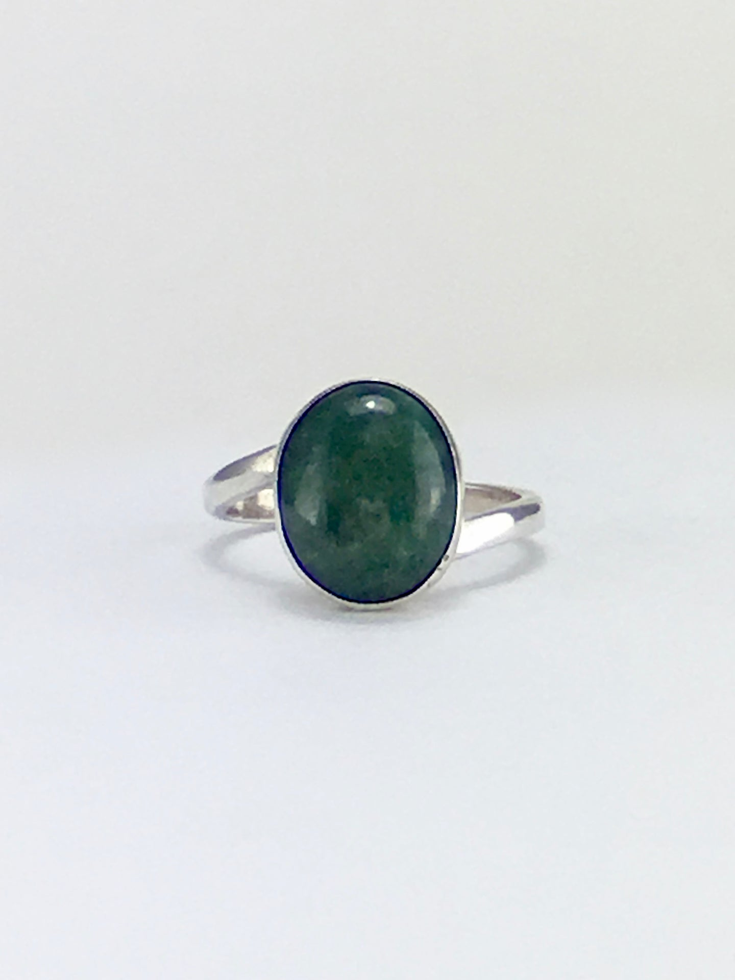 Twisted elegance dark green gemstone jade oval cocktail ring