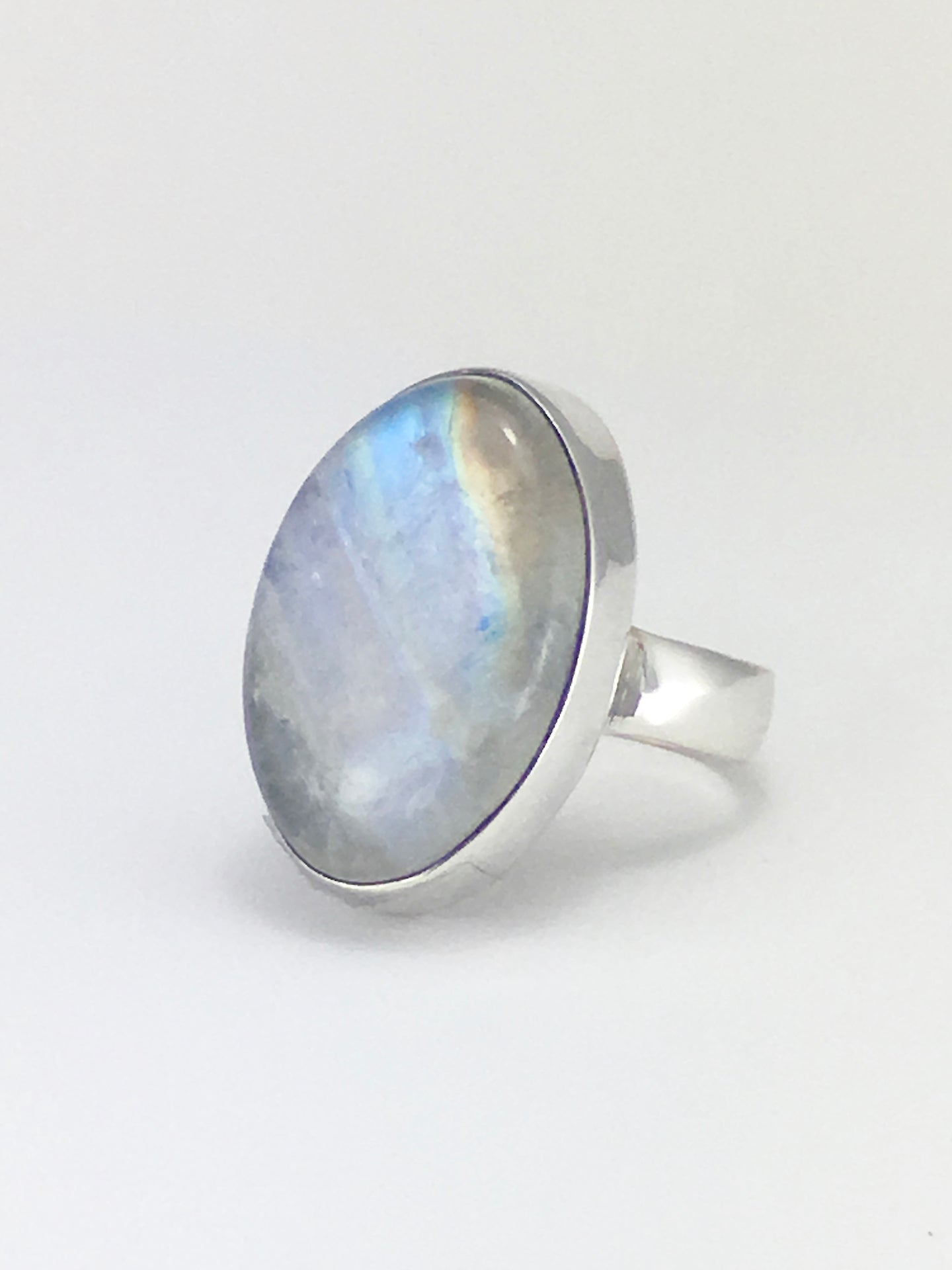 Golden rainbow large moonstone cabochon sterling silver ring