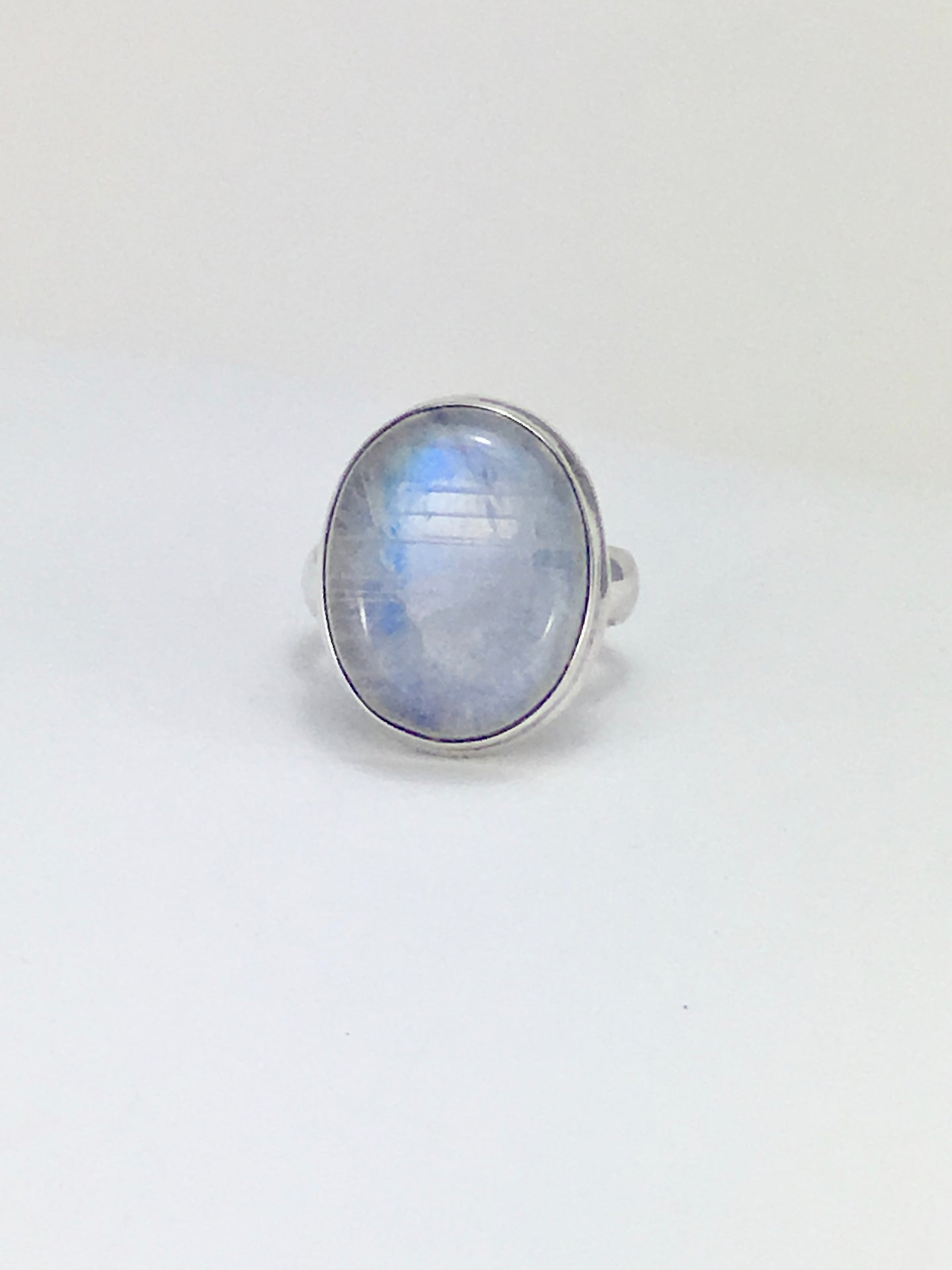 Blue flash moonstone cabochon sterling silver cocktail ring
