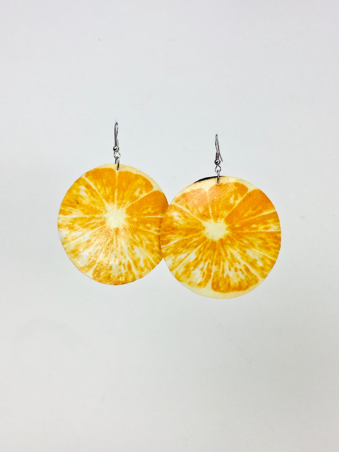 Large shell handcrafted dangle earrings Media Naranja print