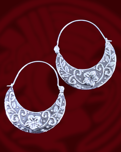 Floral design and silver hoop earrings