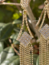 Princess bedazzled dangle earring in 18 kt yellow gold plating and cz