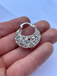 Medium round bedazzled basket hoop earrings in 14kt white gold plating