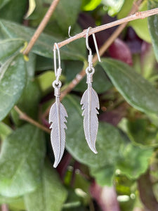 Small feather dangle earrings in sterling silver