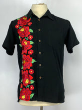 Button down short sleeve large red floral embroidery on black rayon.