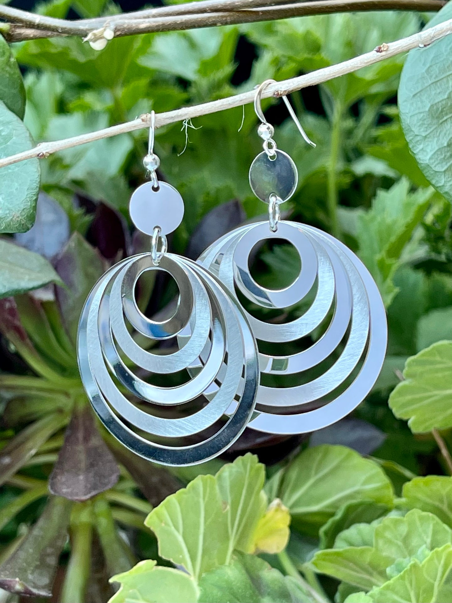 Round modern dangle sterling silver earrings