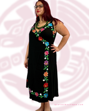 Line A wrap dress in black rayon and florar embroidery