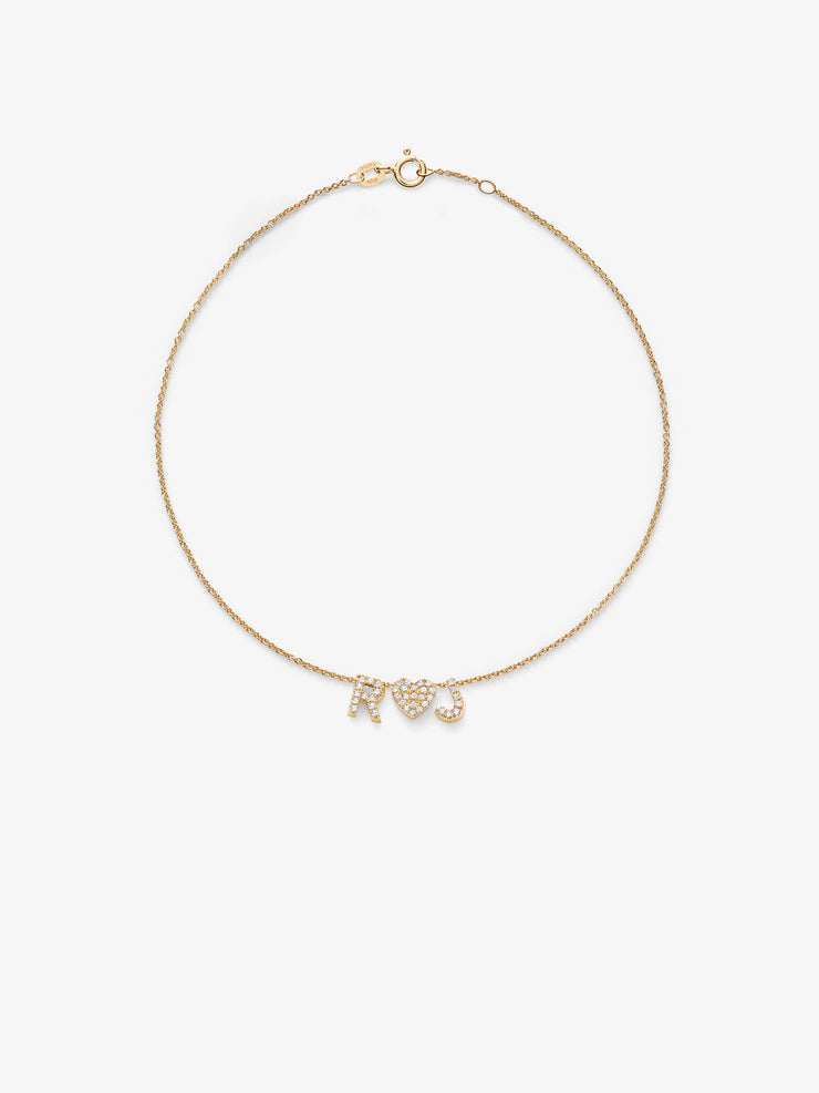 Discover our handcrafted Love Letters Diamond Bracelet in 18-karat solid gold with initials from the alphabet you can personalise with stars and hearts.