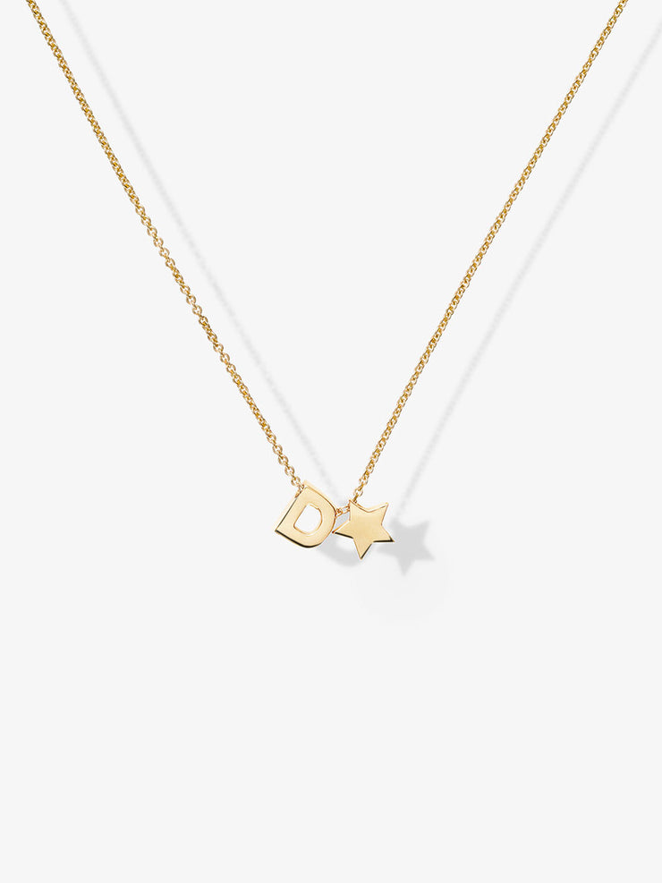 Discover our handcrafted Love Letters One Necklace in 18-karat solid gold including a pendant with 1 initial from the alphabet, hearts and stars.