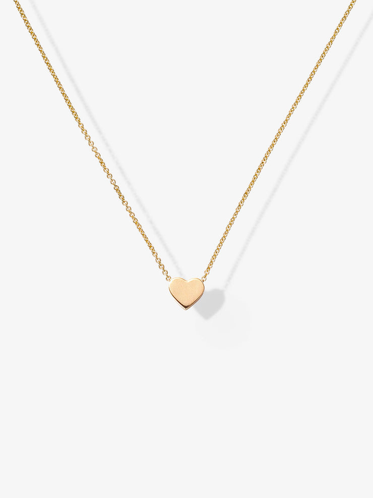 Discover our handcrafted Love Letters Heart Necklace in 18-karat solid gold with an adjustable necklace chain.