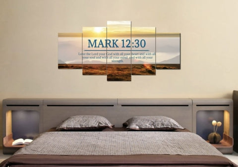 Mark 12:30 bible verse wall art in the bedroom above gray bed