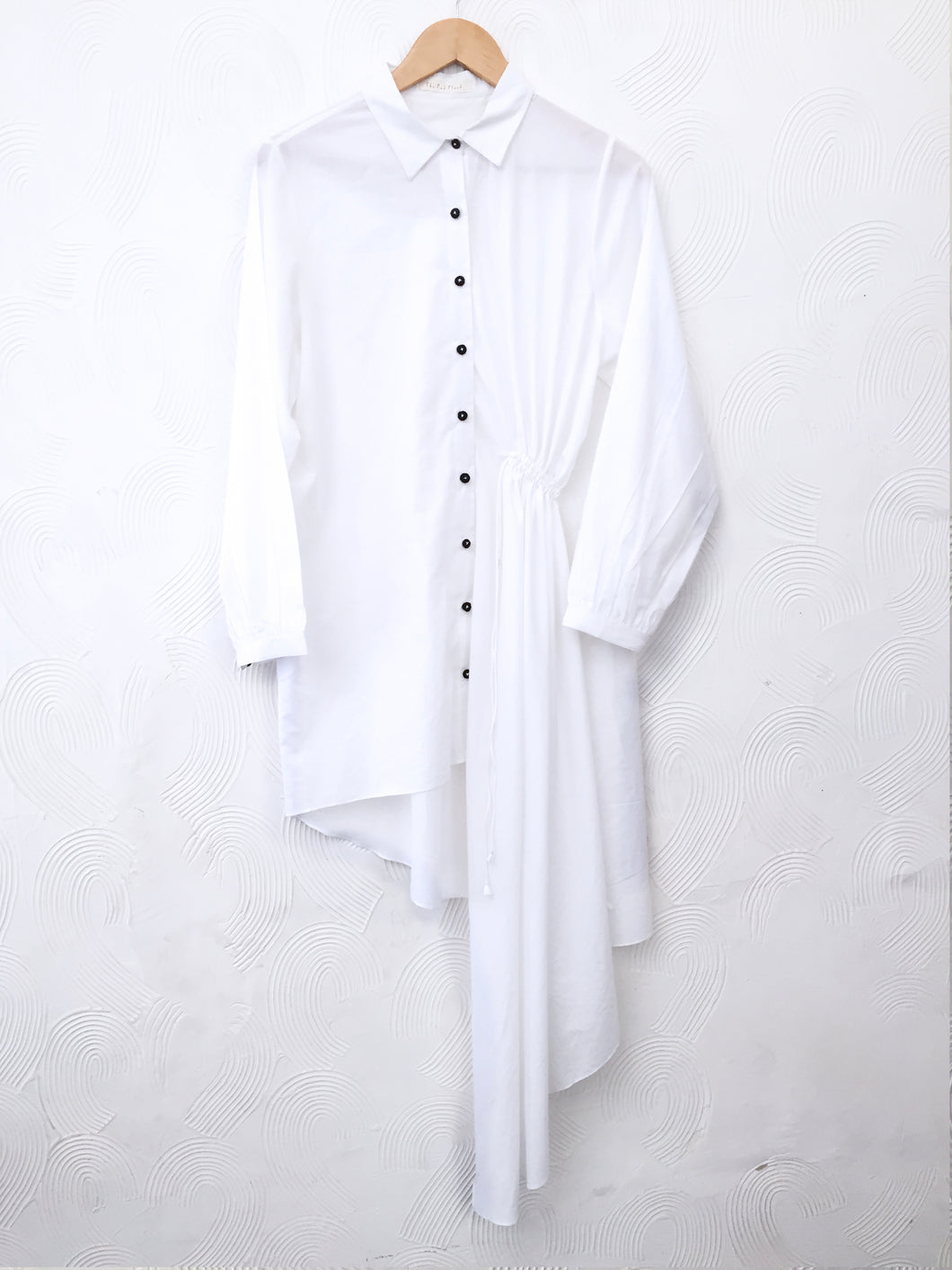 White asymmetrical shirt dress with black crochet buttons